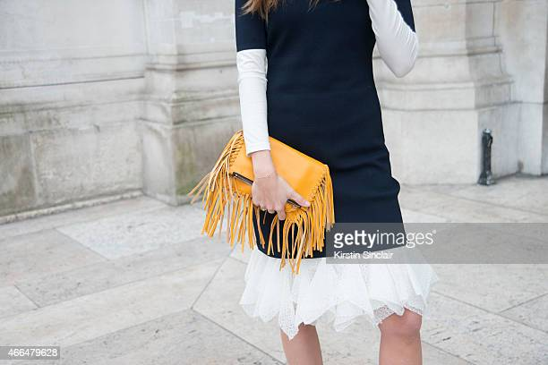 Fashion blogger Gala Gonzalez wears a Carolina Herrera dress and bag day 7 of Paris Collections Women on March 09 2015 in Paris France