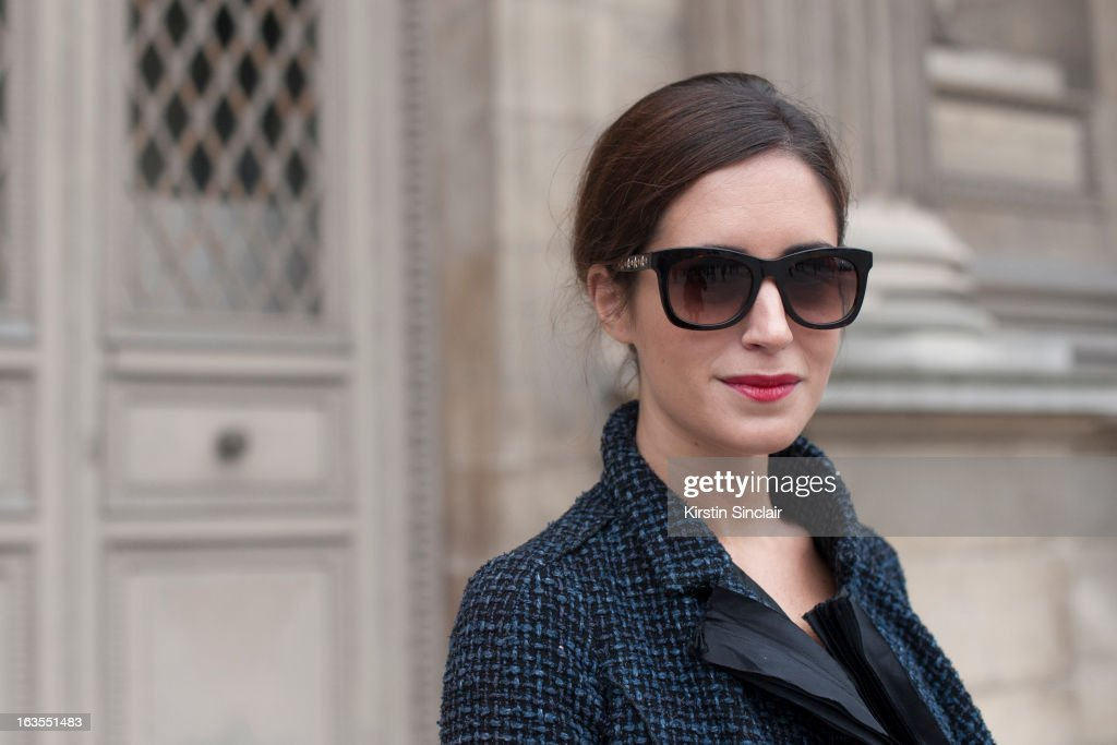 Fashion Blogger Gala Gonzalez wears a Louis Vuitton suit and Jimmy Choo sunglasses on day 7 of Paris Womens Fashion Week Autumn/Winter 2013 on March 06, 2013 in Paris, France.