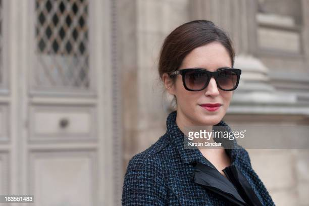 Fashion Blogger Gala Gonzalez wears a Louis Vuitton suit and Jimmy Choo sunglasses on day 7 of Paris Womens Fashion Week Autumn/Winter 2013 on March...