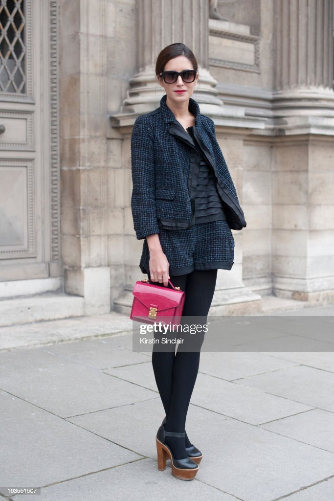 Fashion Blogger Gala Gonzalez wears a Louis Vuitton suit, bag and top, Top Shop shoes and Jimmy Choo sunglasses on day 7 of Paris Womens Fashion Week Autumn/Winter 2013 on March 06, 2013 in Paris, France.