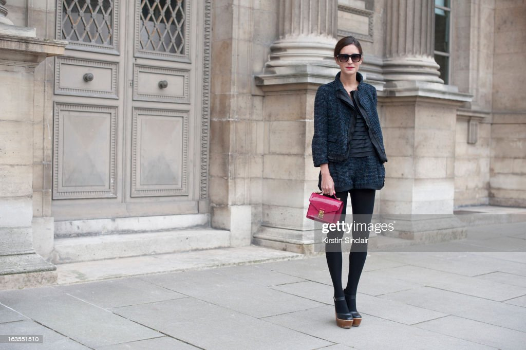 Fashion Blogger <a gi-track='captionPersonalityLinkClicked' href=/galleries/search?phrase=Gala+Gonzalez&family=editorial&specificpeople=7511211 ng-click='$event.stopPropagation()'>Gala Gonzalez</a> wears a Louis Vuitton suit, bag and top, Top Shop shoes and Jimmy Choo sunglasses on day 7 of Paris Womens Fashion Week Autumn/Winter 2013 on March 06, 2013 in Paris, France.