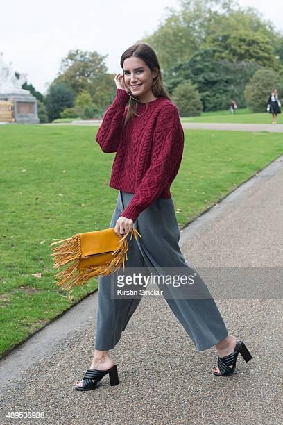 Fashion blogger Gala Gonzalez wears Isabel Marant sweater Carolina Herrera bag Atterley trousers Senza shoes on day 4 during London Fashion Week...