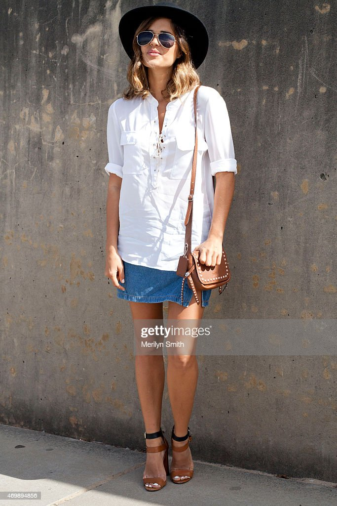 Fashion Blogger Geneva Vanderzeil wears a Lack of Color hat vintage skirt Witchery top and Zara hells at MercedesBenz Fashion Week Australia 2015 at...