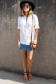 Fashion Blogger Geneva Vanderzeil wears a Lack of Color hat vintage skirt Witchery top and Zara hells at MercedesBenz Fashion Week Australia 2015 at...