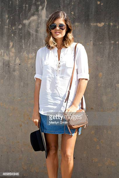 Fashion Blogger Geneva Vanderzeil wears a Lack of Color hat vintage skirt and Witchery top at MercedesBenz Fashion Week Australia 2015 at...
