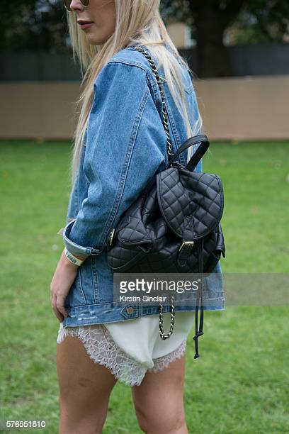 Fashion blogger Georgia White wears Asos sunglasses bag and jacket and a White Label playsuit on day 1 of Lovebox Festival on July 15 2016 in...