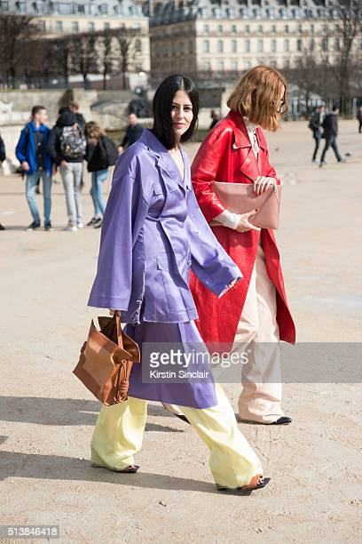 Fashion Blogger Gilda Ambrosio wears a Loewe Pyjama suit and bag and Candela Novembre wears a Marni jacket Trussardi trousers and shirt Rochas bag...