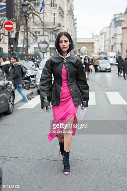 Fashion blogger Gilda Ambrosio wears an Alexander Rich dress Dior jacket and Dries Van Noten boots on day 4 of Paris Haute Couture Fashion Week...