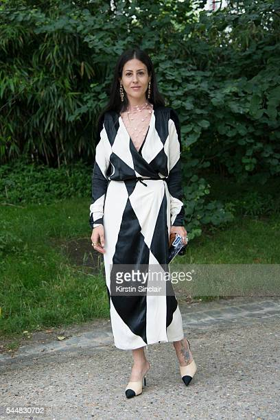 Fashion Blogger Gilda Ambrosio wears an Attico dress and Chanel shoes on day 1 of Paris Haute Couture Fashion Week Autumn/Winter 2016 on July 3 2016...