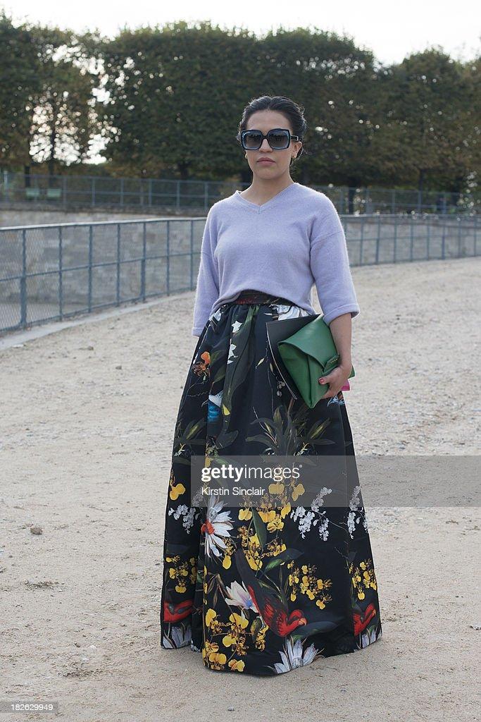 Fashion blogger Gina Ortega wears Alison Olivia skirt, vintage top, Olivia Goldstein sunglasses and a Givenchy clutch bag on day 7 of Paris Fashion Week Spring/Summer 2014, Paris September 30, 2013 in Paris, France.