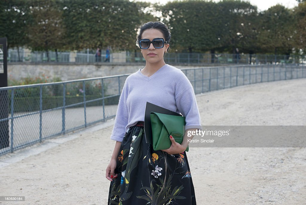 Fashion blogger Gina Ortega wears Alison Olivia skirt, vintage top, Olivia Goldstein sunglasses and a Givenchy clutch bag on day 7 of Paris Fashion Week Spring/Summer 2014, Paris September 30, 2013 in Paris, France.