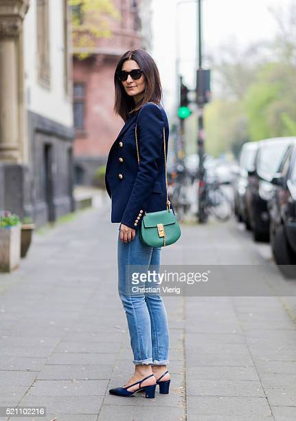 Fashion blogger Golestaneh MayerUellner wearing dark blue Balmain blazer with golden buttons blue Acne Studios denim jeans green Chloe bag Celine...