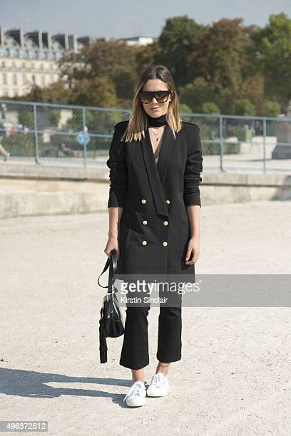 Fashion Blogger Hannah Crosskey wears a Super Trash blazer Topshop trousers Mango bag Superga shoes and Celine sunglasses on day 5 during Paris...