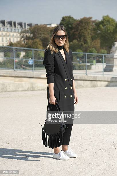 Fashion Blogger Hannah Crosskey wears a Super Trash blazer Topshop trousers Mango bag Superga shoes and Celine sunglasses on day 5 during Paris...