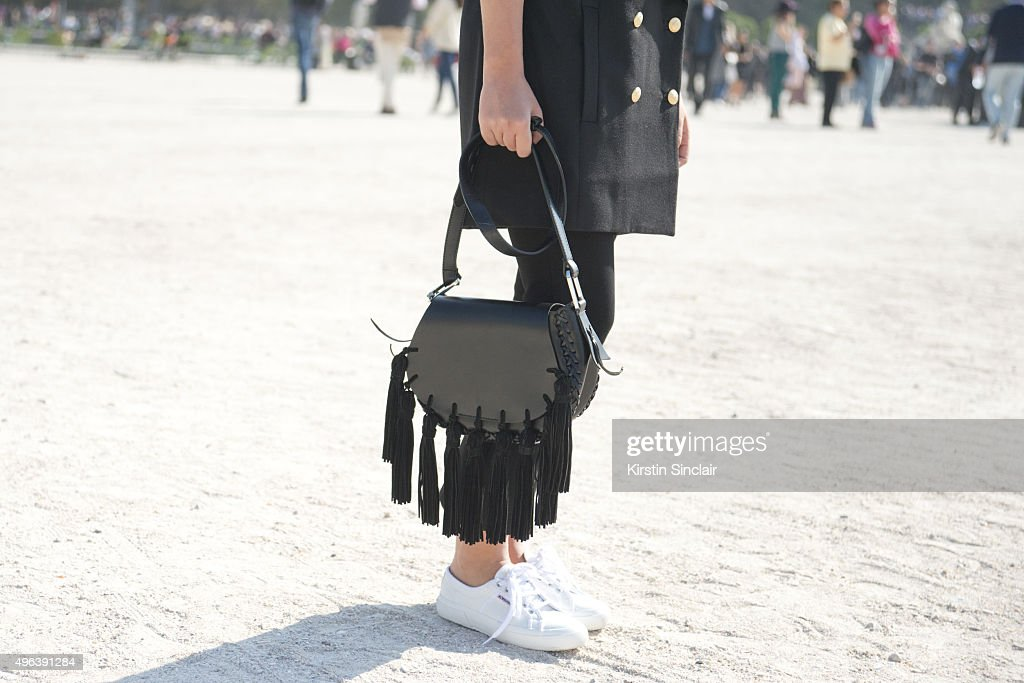 Fashion Blogger Hannah Crosskey wears a Super Trash blazer Topshop trousers Mango bag and Superga shoes on day 5 during Paris Fashion Week...