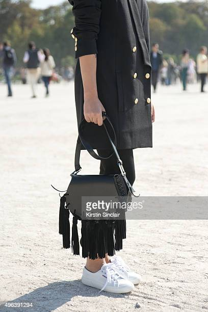 Fashion Blogger Hannah Crosskey wears a Super Trash blazer Topshop trousers Mango bag and Superga shoes on day 5 during Paris Fashion Week...