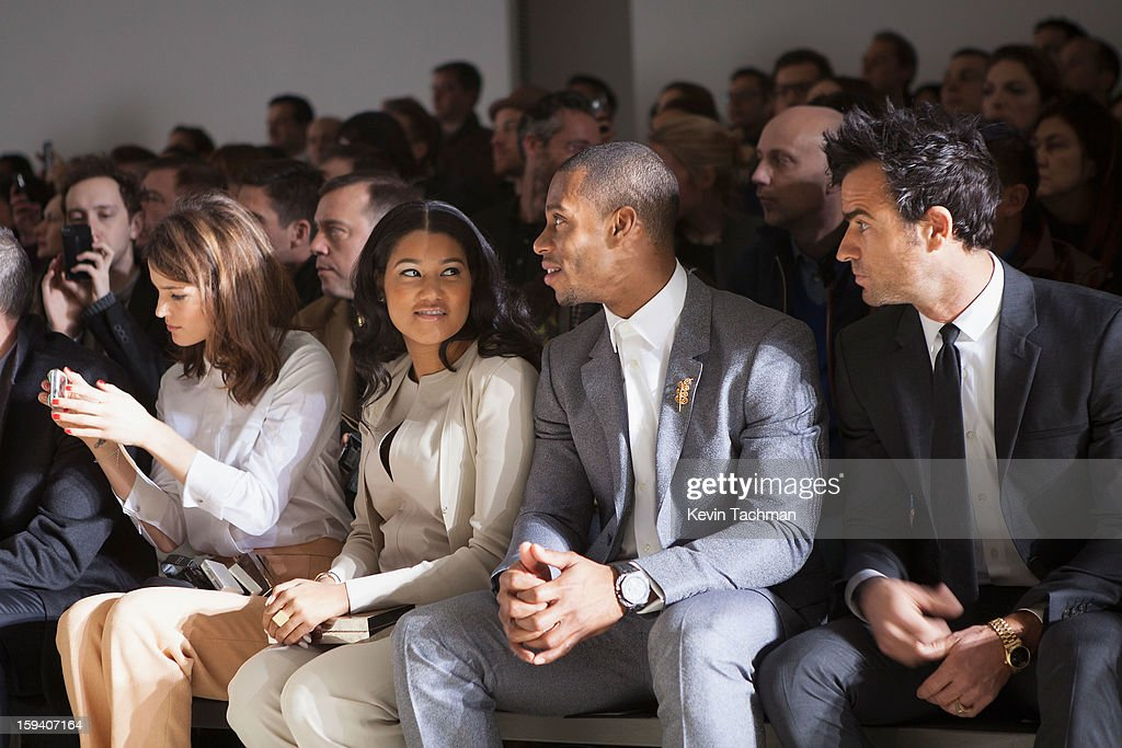 Fashion blogger Hanneli Mustaparta, Elaina Watley, Victor Cruz and Justin Theroux attend the Calvin Klein Collection show as part of Milan Fashion Week Menswear Autumn/Winter 2013 on January 13, 2013 in Milan, Italy.