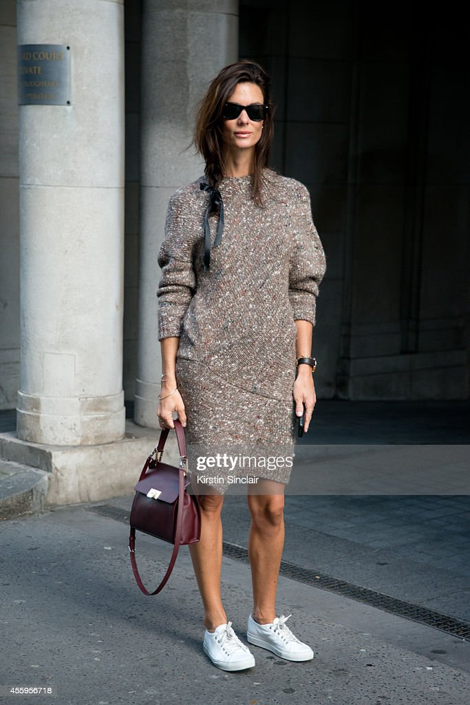 Fashion Blogger Hedvig Opshaug is wearing a Stella McCartney dress Balenciaga bag Rayban sunglasses and Common Project trainers on day 4 of London...