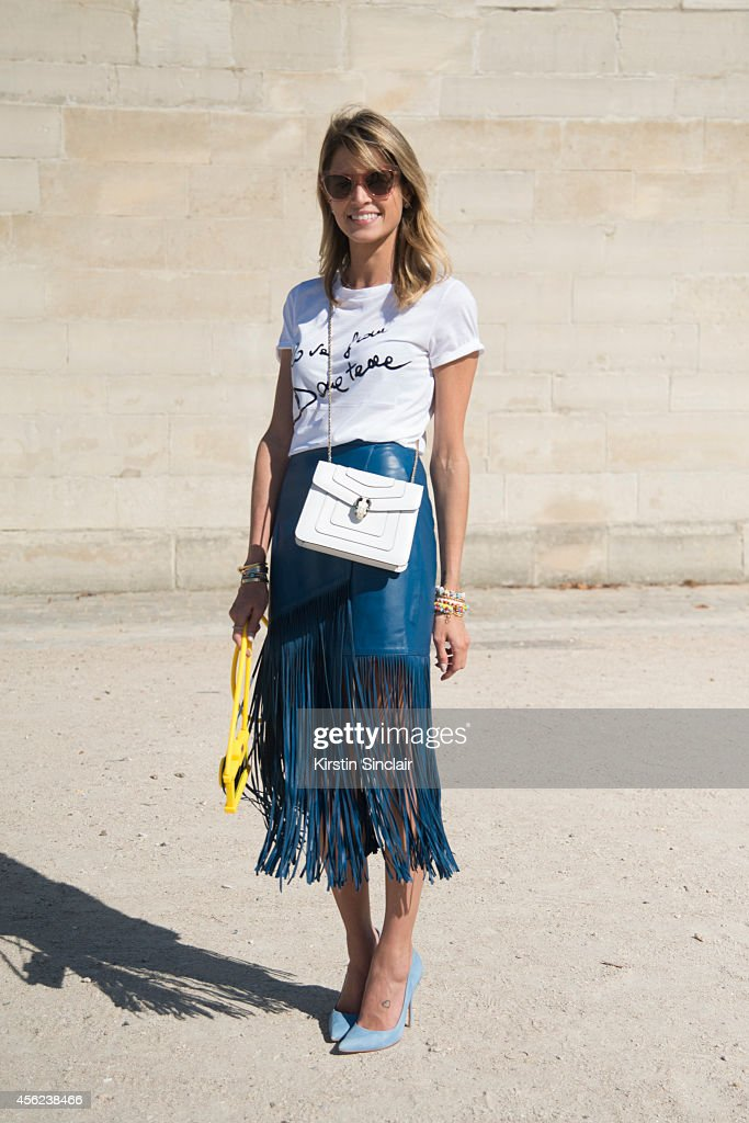 Fashion Blogger Helena Bordon is wearing Lilly Sarti skirt Versace top Bulgari bag Schutz shoes Miu Miu sunglasses and Moschino iPhone case on day 4...