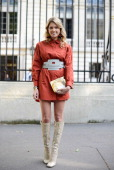 Fashion blogger Helena Bordon poses wearing a Tod's outfit Charlotte Olympia clutch and Miu Miu shoes before Atelier Versace show on July 6 2014 in...