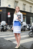 Fashion Blogger Helena Bordon poses wearing a Zara shirt David Koma skirt and an Olympia Le Tan clutch before Vionnet show on July 9 2014 in Paris...