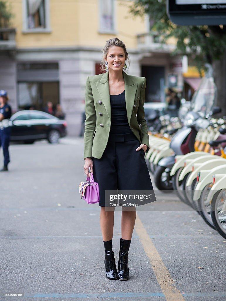 Fashion blogger Helena Bordon wearing Miu Miu earings Balmain jacket Victor Rolf pants and Paula Cademartori bag during Milan Fashion Week...