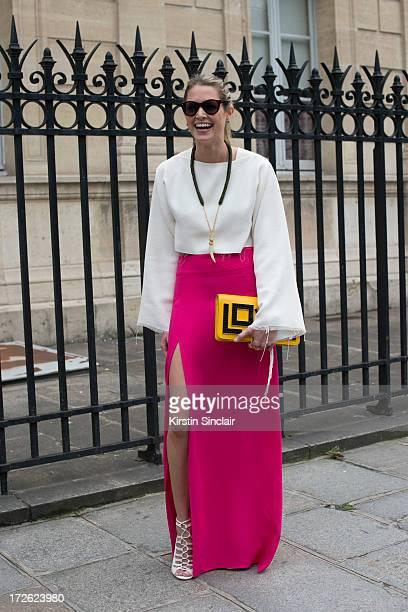 Fashion blogger Helena Bordon wears a Celine top Lily skirt Illesteva sunglasses Luiza Barcelos shoes and a Maria Sole bag on day 3 of Paris...