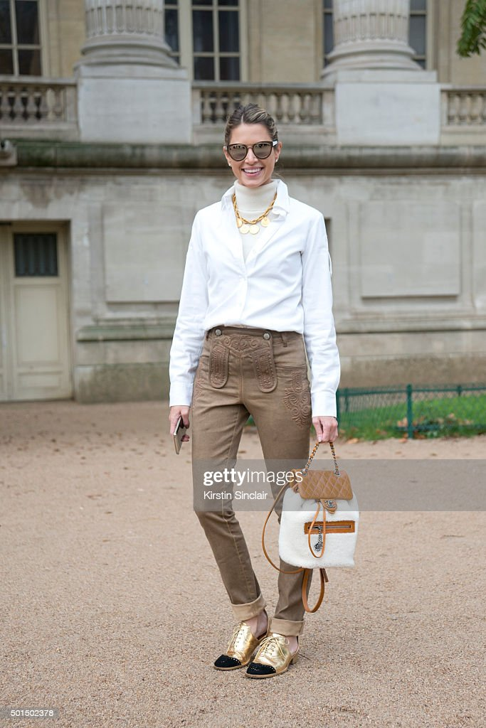 Fashion Blogger Helena Bordon wears a Chanel bag trousers and shoes Zara shirt Fendi necklace and Dior sunglasses on day 8 during Paris Fashion Week...