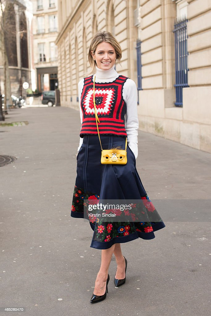 Fashion blogger Helena Bordon wears a Fendi bag, Miu Miu top, Celine skirt and Schutz shoes on day 2 of Paris Collections: Women on March 04, 2015 in Paris, France.