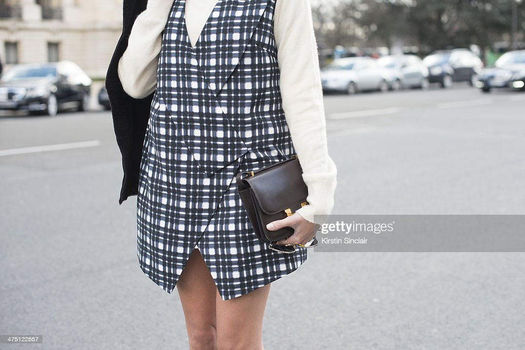 Fashion Blogger Helena Bordon wears a Hermes bag, Ralph Lauren sweater, Finders Keepers dress on day 2 of Paris Collections: Women on February 26, 2014 in Paris, France.