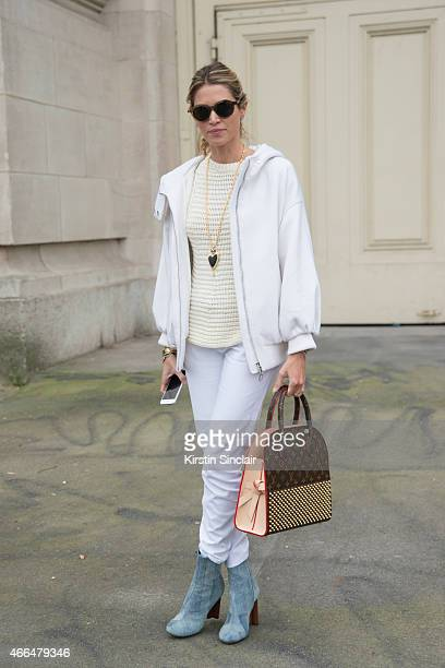 Fashion blogger Helena Bordon wears a Louis Vuitton bag and boots and Dior jacket on day 7 of Paris Collections Women on March 09 2015 in Paris France