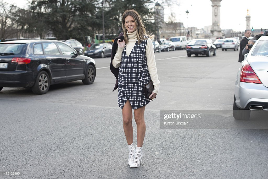 Fashion Blogger Helena Bordon wears an Hermes bag, Ralph Lauren sweater, Barbara Bui shoes, Finders Keepers dress and Gucci jacket on day 2 of Paris Collections: Women on February 26, 2014 in Paris, France.