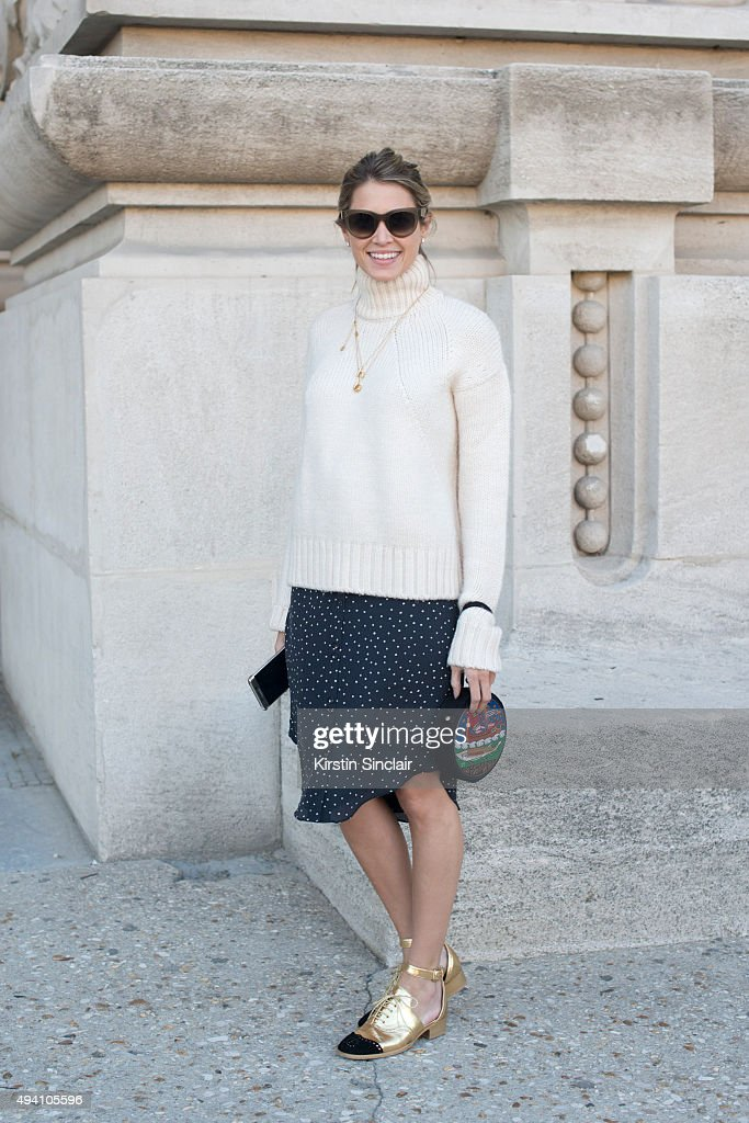 Fashion Blogger Helena Bordon wears Celine sunglasses Zara sweater Cris Barros skirt and Chanel shoes on day 3 during Paris Fashion Week...