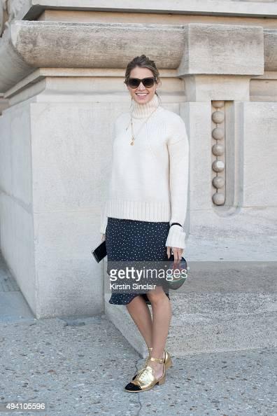 Fashion Blogger Helena Bordon wears Celine sunglasses Zara sweater Cris Barros skirt and Chanel shoes on day 3 during Paris Fashion Week...
