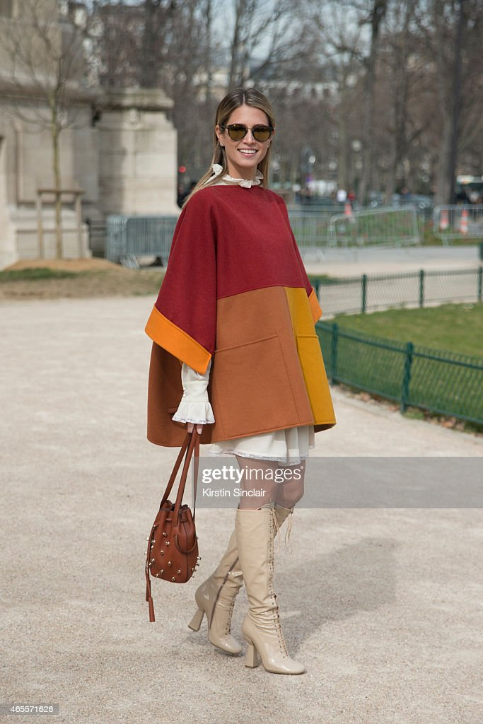 Fashion blogger Helena Bordon wears Miu Miu boots Philosophy cape and dress Todâs bag Kyme sunglasses on day 5 of Paris Collections Women on March 07...