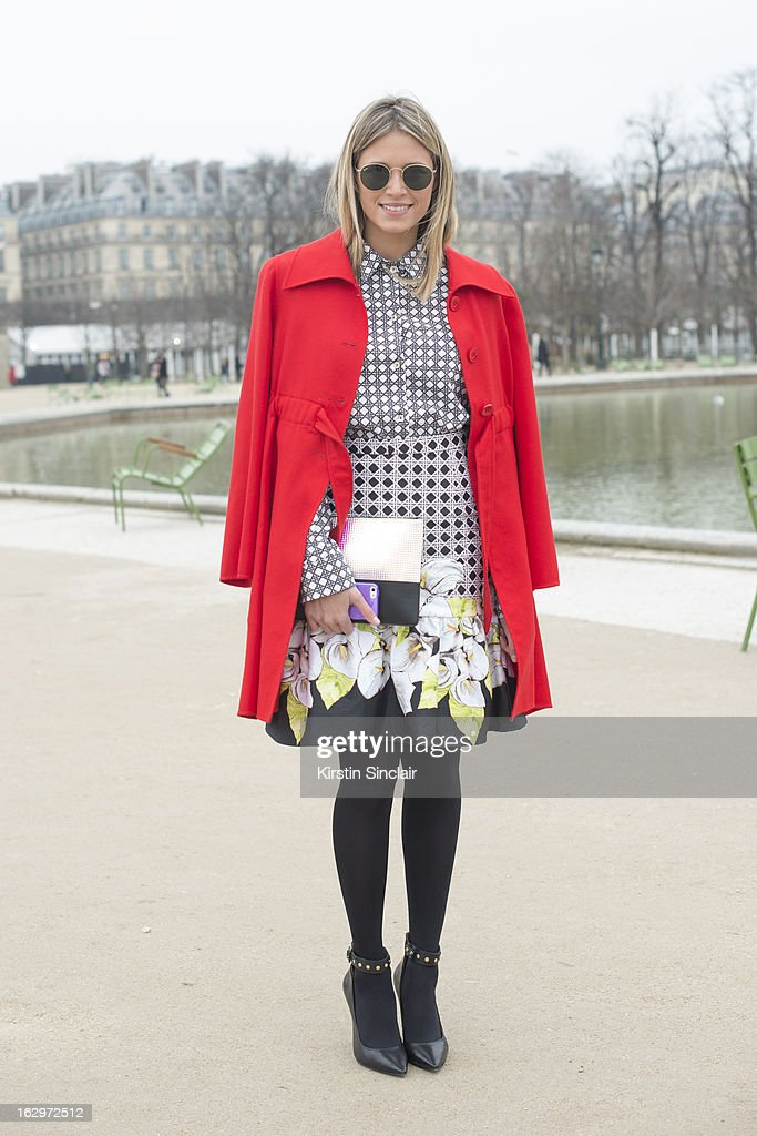 Fashion blogger Helena Bordon wears Rag and Bone sunglasses, Valentino jacket, shoes by My Shoes Brasil, Celine bag and Isolda dress and skirt on day 2 of Paris Womens Fashion Week Autumn/Winter 2013 on March 1, 2013 in Paris, France.