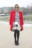 Fashion blogger Helena Bordon wears Rag and Bone sunglasses Valentino jacket shoes by My Shoes Brasil Celine bag and Isolda dress and skirt on day 2...