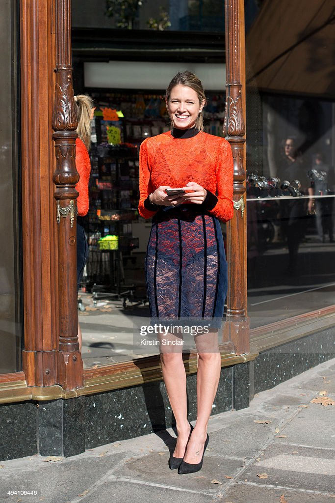 Fashion Blogger Helena Bordon wears Shutz shoes and a Balmain dress on day 3 during Paris Fashion Week Spring/Summer 2016/17 on October 1 2015 in...
