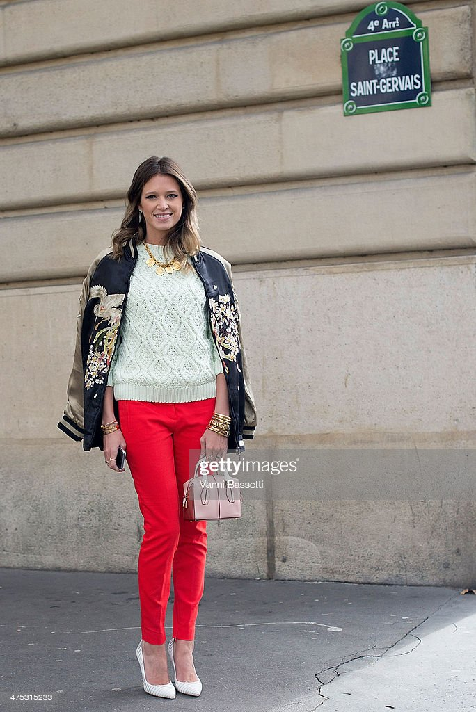 Fashion blogger Helena Bordon wears Zara jacket, tousers, sweaters, a Tod's bag and Gianvito Rossi shoes before Dries Van Noten show at the Hotel de Ville on February 26, 2014 in Paris, France.