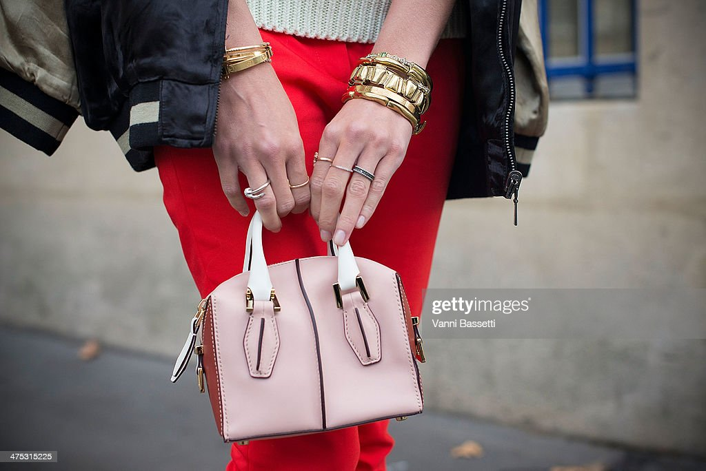 Fashion blogger Helena Bordon wears Zara jacket, tousers, sweaters, and Tod's bag before Dries Van Noten show at the Hotel de Ville on February 26, 2014 in Paris, France.