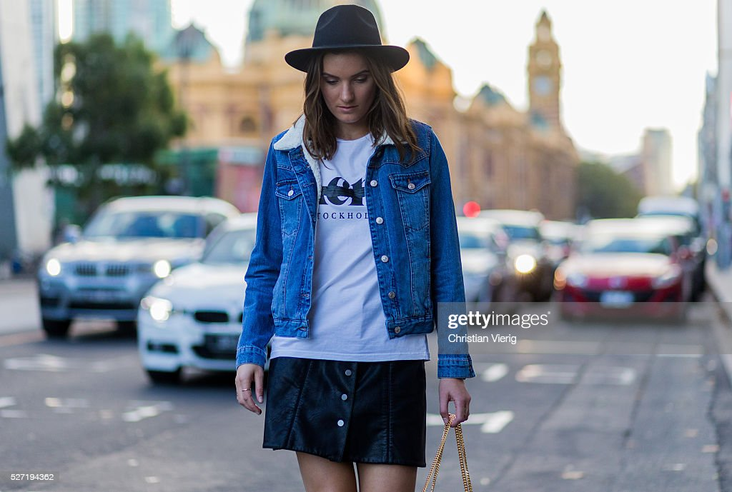 Fashion blogger Holly Titheridge wearing a white Acne thsirt, a Topshop denim jacket, a black hat, a black Witchery leather skirt with buttons, a black Yves Saint Laurent bag on May 2, 2016 in Melbourne, Australia