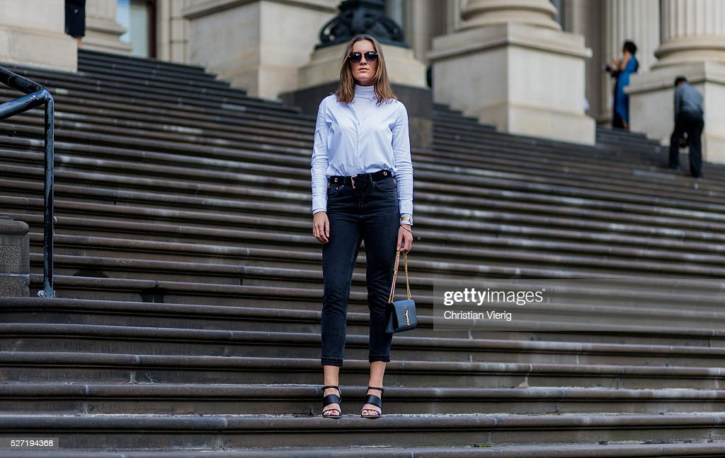 Fashion blogger Holly Titheridge wearing black sunglasses, a white Topshop button shirt, black Topshop denim jeans, black Alias Mae heel sandals, black Yves Saint Laurent bag on May 2, 2016 in Melbourne, Australia