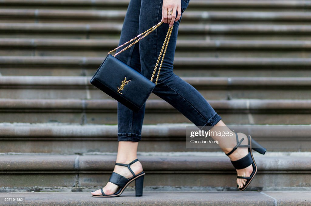 Fashion blogger Holly Titheridge wearing black Topshop denim jeans, black Alias Mae heel sandals, black Yves Saint Laurent bag on May 2, 2016 in Melbourne, Australia
