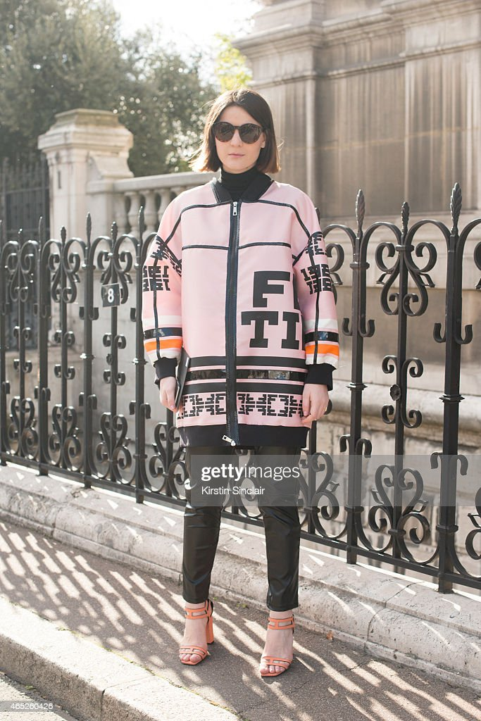 Fashion blogger Irene Buffa wears Fay coat and Asos sunglasses on day 2 of Paris Collections: Women on March 04, 2015 in Paris, France.