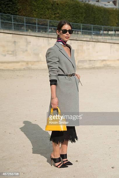 Fashion Blogger Irina Lakicevic is wearing a Louis Vuittonbag Rayban sunglasses Phillipa Kay coat Isabel Marant skirt and Altuzarra shoes on day 8 of...