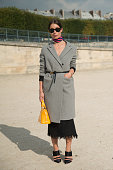 Fashion Blogger Irina Lakicevic is wearing a Louis Vuittonbag Rayban sunglasses Phillipa Kay coat Isabel Marant skirt and Altuzarra shoes on day 8 of...