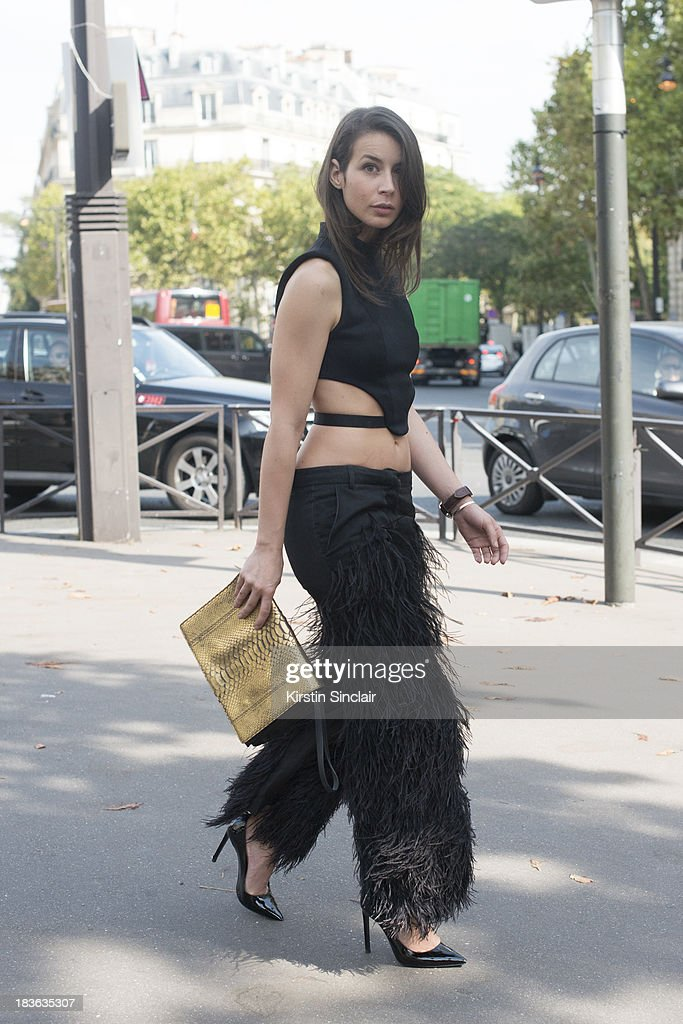 Fashion blogger Irina Lakicevic wearing a Barbara Bui top trousers and bag with Saint Laurent shoes on day 9 of Paris Fashion Week Spring/Summer 2014, Paris October 02, 2013 in Paris, France.