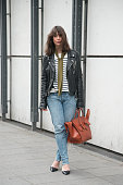 Fashion blogger Irina Lakicevic wears a BLK DNM jacket Saint Laurent top vintage levis jeans Jimmy Choo shoes Prada scarf and Celine bag on day 7 of...