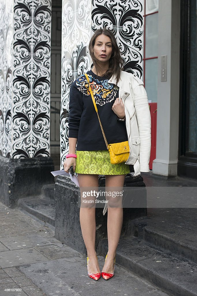 Fashion Blogger Irina Lakicevic wears a Christopher Kane skirt, Marc Jacobs bag, Christian Louboutin shoes, Full Winter Spring Summer sweater and a BLK DNM jacket on day 4 of London Fashion Week Spring/Summer 2013, at Somerset House on September 16, 2013 in London, England.