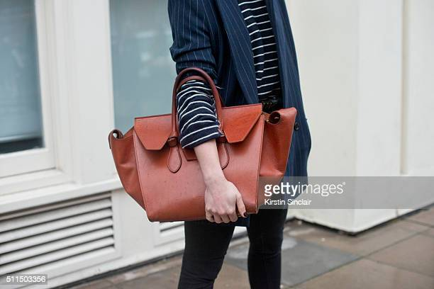 Fashion Blogger Irina Lakicevic wears a Ganni jacket Celine top and bag on day 2 during London Fashion Week Autumn/Winter 2016/17 on February 20 2016...